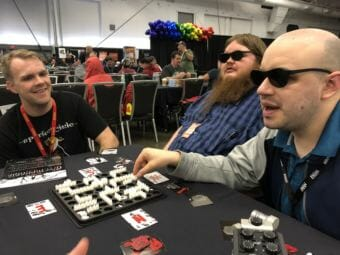 (From left) Judson Rusk, Calvin Drank and Seaton Bryan play Nyctophobia, a board game where players are unable to see the board. The three traveled to SHUX earlier this fall to try new board games and meet the creators of some of their favorites.