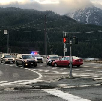 Police close one lane of the Douglas Bridge in Juneau the afternoon of Nov. 30, 2018, after two cars collided head on.