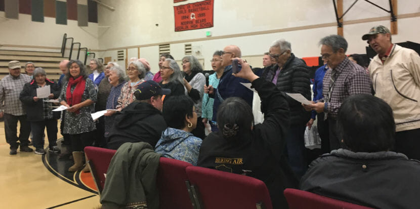 Noorvik elders sing the hymn Aarigaa to welcome Gov. Mike Dunleavy, Rose Dunleavy and other dignitaries, Dec. 3, 2018. (Photo by Andrew Kitchenman/KTOO and Alaska Public Media)