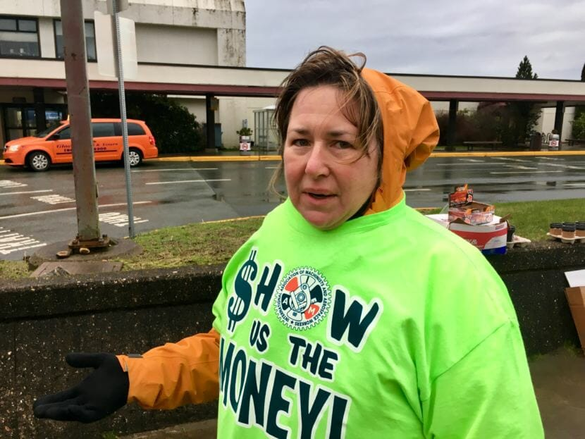 "Carolyn Sharp says she's seen ""a lot of good, a lot of bad. It's a great company. It just needs to step up a little bit,"" during a workers' rally at Juneau International Airport on Saturday. Sharp has worked for Alaska Airlines for 31 years."