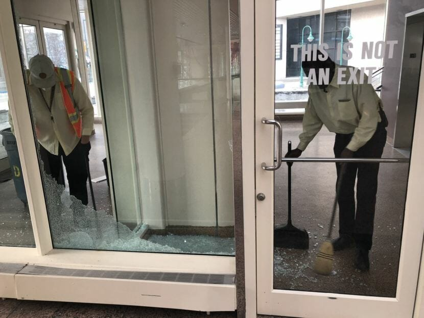 A broken window gets swept up after the Nov. 30, 2018, earthquake in Anchorage.