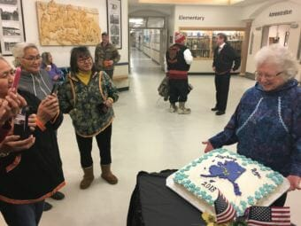 Donna Zibell shows off the cake she baked for Gov. Mike Dunleavy's inauguration celebration in Noorvik, Dec. 3, 2018. (Photo by Andrew Kitchenman/KTOO and Alaska Public Media)