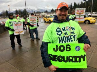 John Walters rallies Alaska Airlines workers at Juneau International Airport on Dec. 8, 2018.