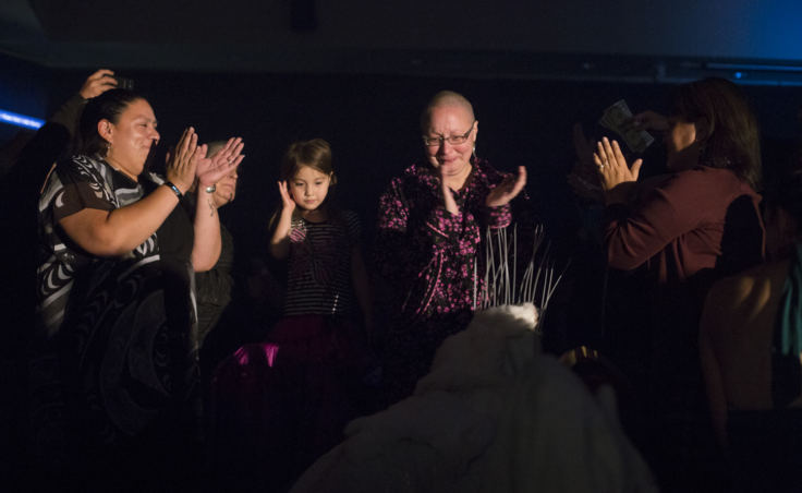 "Mary Folletti and her family cheer on Juneau artist Ricky Tagaban during his performance at the""Besties for Breasties"" drag show medical fundraiser on September 21, 2018."