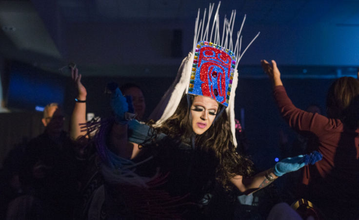 Performing as the drag persona Lituya Hart, Tlingit artist Ricky Tagaban wears a Shakee.át headress made created from glitter foam, duct tape, ermine, rabbit fur, and zip ties in place of sea lion whiskers.