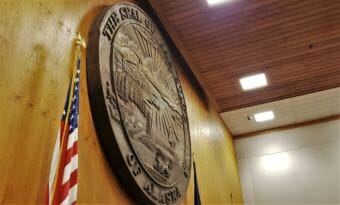 This massive seal of the state of Alaska hangs on April 19, 2018, behind the dais where Alaska Supreme Court justices hear cases in the Boney Courthouse in Anchorage.