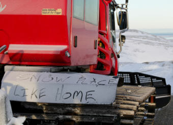 Detail written in snow on the PistenBully –Snow Place Like Home.