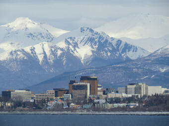 Downtown Anchorage seen from just west of Earthquake Park on the Knik Arm of the Cook Inlet.