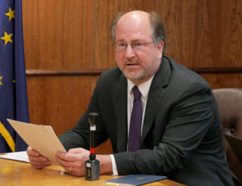 Attorney General Kevin Clarkson reads summaries of three constitutional amendments proposed by Gov. Mike Dunleavy to reporters at a press conference in the Capitol in Juneau on Jan. 30, 2019.