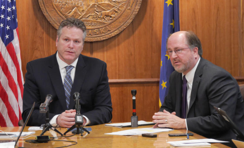 Gov. Mike Dunleavy, left, and Attorney General Kevin Clarkson discuss the governor's proposed budget- and Alaska Permanent Fund dividend-related constitutional amendments with reporters at a press conference held at the Capitol in Juneau on Jan. 30, 2018.