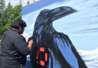 "Artist Dwayne ""Dwayno Insano"" Manuel painting at the Anchorage Museum."