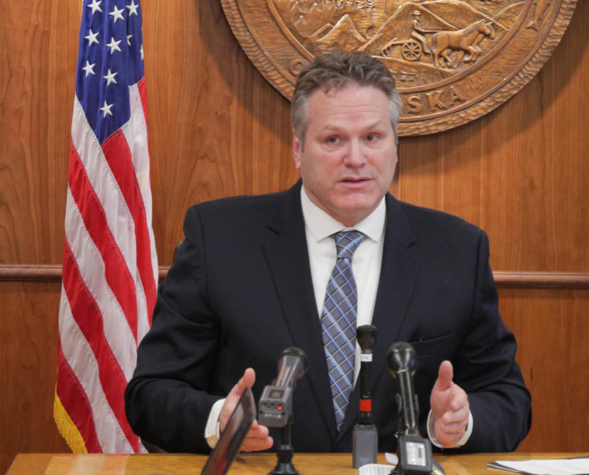 Gov. Mike Dunleavy discusses his proposed budget- and Alaska Permanent Fund dividend-related constitutional amendments with reporters at a press conference in the Capitol in Juneau on Jan. 30, 2018.