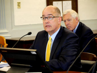 Alaska Mental Health Trust Authority CEO Mike Abbott gives an overview of the organization to the Senate Finance Committee, in Juneau on Jan. 31, 2019. He also fielded questions from senators about criticisms of the trust found in a legislative audit.