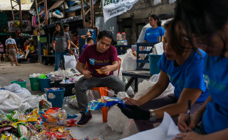 Froilan Grate calls out the brand names of plastic trash in a waste audit.