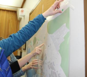 Juneau residents place dots on a map at a local meeting addressing air quality concerns from cruise ships.