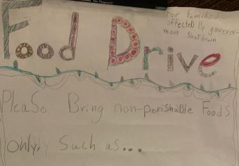Students at Montessori Borealis made posters to advertise their food drive in Jan. 2019 to replenish the Southeast Alaska Food Bank, which saw increased demand during the partial government shutdown. (Photo courtesy of Callie Conerton)