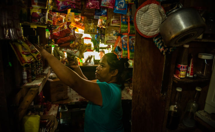 Nimfa Manlabe, 46, boosts her income by selling consumer goods in sachets from her sari-sari store in her home in Manila. This is a common way for Filipinos to get their daily supplies. (Photo by Jes Aznar for NPR)