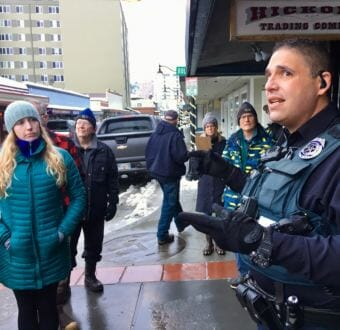 JPD officer Ken Colón shares his perspective on public safety in Juneau's tourist district on a Blueprint Downtown walking tour on Jan. 12, 2019. (Photo by Zoe Grueskin/KTOO)