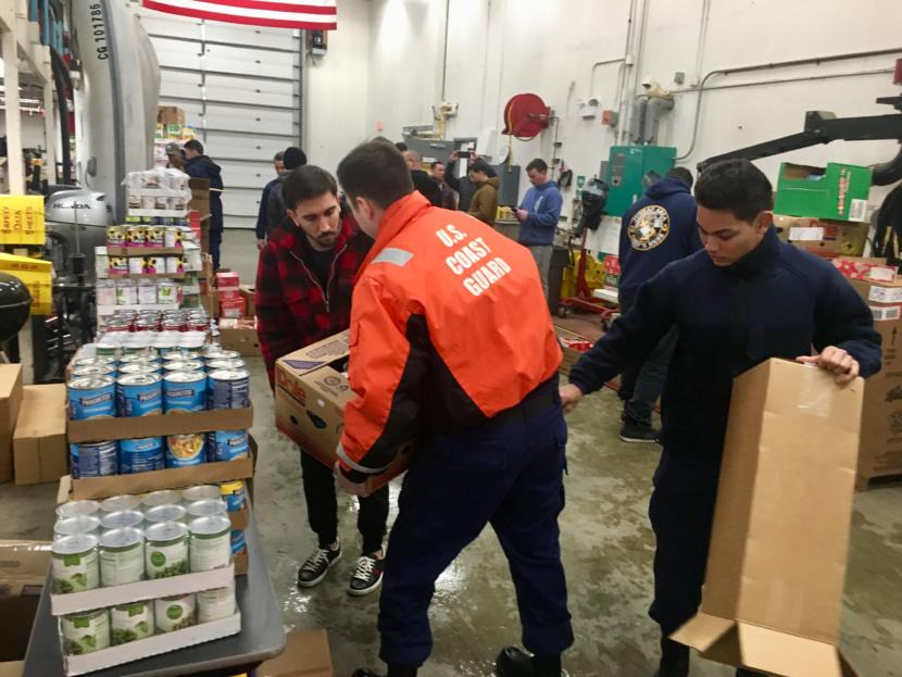 Coast Guard members unpack donations to the consumables pantry on Jan. 22, 2019. (Photo by Zoe Grueskin/KTOO)