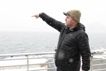 Silver Bay Seafoods representative Tommy Sheridan answers questions on Feb. 4, 2019, from the bow of a chartered boat near Olga Point.