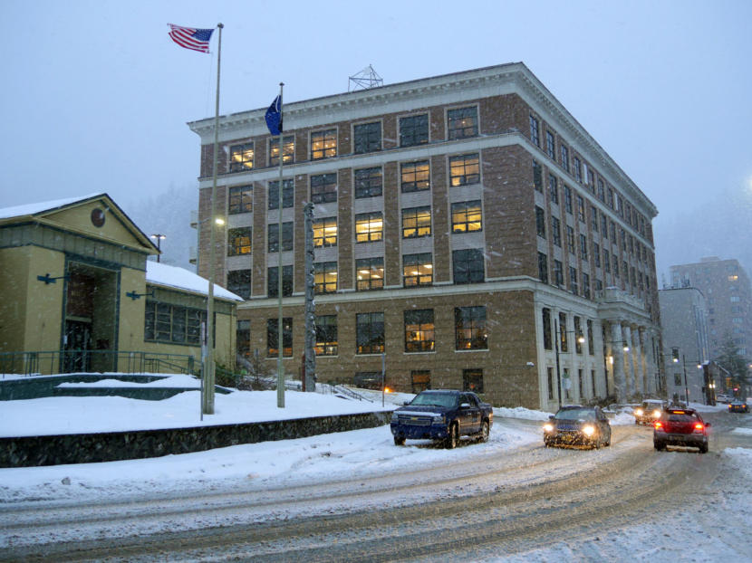 Snow falls on the Alaska State Capitol in Juneau on Feb. 18, 2019.