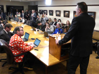 Gov. Michael Dunleavy introduces his state budget to reporters at a press availability at the Capitol in Juneau on Feb. 13, 2019.