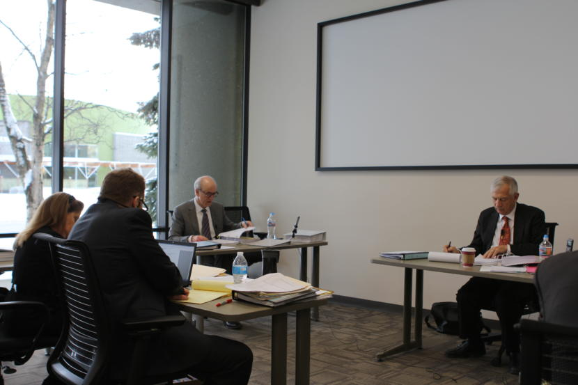Hollis French, center, testifies at a Feb. 8, 2019 hearing regarding whether he should be fired from his post at AOGCC for cause.