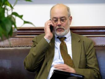 Joe Geldhof talks on the phone in the second floor hallway of the Capitol in Juneau on Feb. 15, 2019.