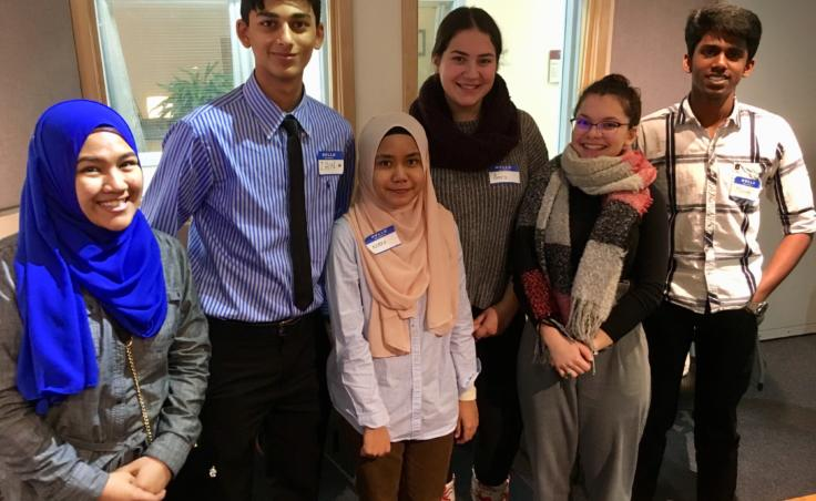 From left: Nisreen Jehka, Zain Mufti, Aziera Azlen, , Amra Kojic, Yulvie Nuri, and Mohan Raj Arul are exchange students in Juneau and Sitka. Azlen was the last to arrive, in early 2019. She says she was encouraged to study abroad by her mother in Malaysia, who attended college in Connecticut. (Photo by Zoe Grueskin/KTOO)