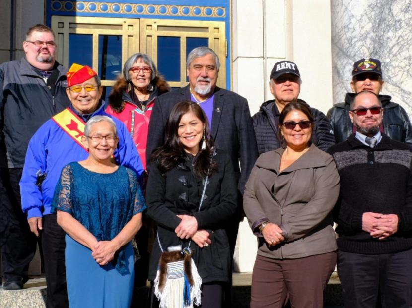 Representatives from Sealaska Heritage, Alaska Native Brotherhood, Central Council of Tlingit & Haida and descendants of the five known Tlingit code talkers on the steps of the capitol on Wednesday.
