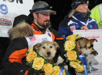 Iditarod 2019 champion Pete Kaiser and his dogs Marrow and Lucy at the end of the 1,000-mile race in Nome.