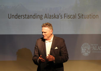 Gov. Mike Dunleavy speaks with a constituent ahead of a presentation at a policy forum organized by Americans for Prosperity's Alaska chapter, March 26, 2019.