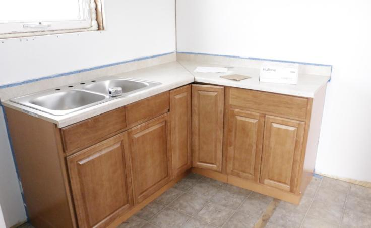 ANTHC installs new kitchen cabinets and sinks in houses to accommodate the new plumbing. Eek, Alaska February 20, 2019.(Photo by Anna Rose MacArthur/KYUK)