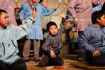 The smallest Kasigluk dancer performs with his community dance group at the Cama-i Dance Festival on March 16, 2018 in Bethel, Alaska. (Photo by Amara Freeman/KYUK)