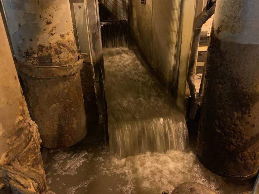 "Raw wastewater enters the treatment facility. The water is strained through a rack first, to catch any ""non-flushables."""