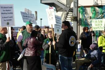 Hundreds of people rallied in downtown Anchorage on March 26, 2019, in protest of Gov. Mike Dunleavy's budget proposal.