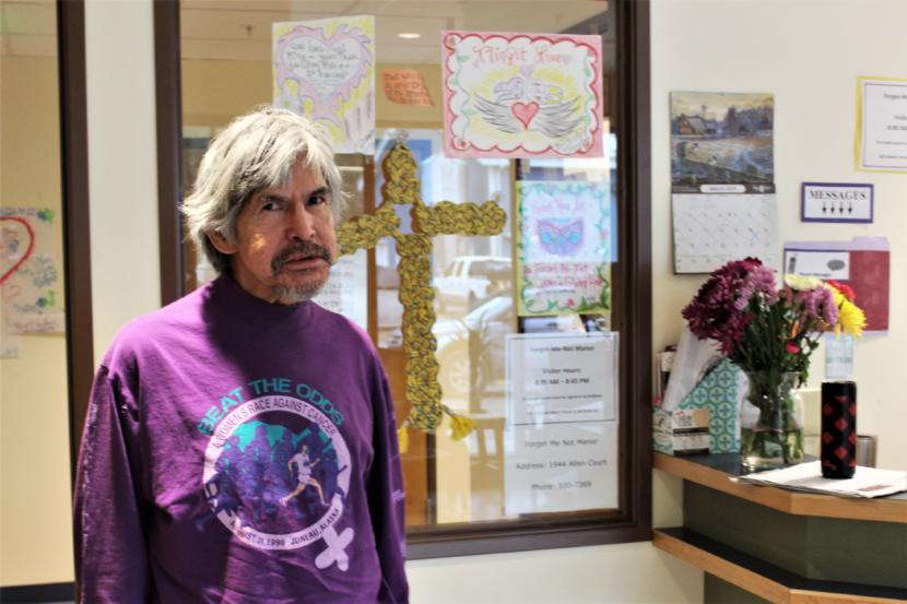 Matthew Fred Jr., who goes by J.R., stands in the lobby of the Housing First complex. (Photo by Adelyn Baxter/KTOO)