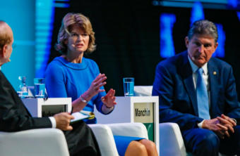 Sens. Lisa Murkowski, R-Alaska, and Joe Manchin, D-W.Va., shown here at 2019 CERAWeek, are talking a lot about climate change.