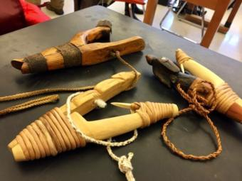 Traditional Tlingit halibut hooks brought as examples to a science class at Juneau-Douglas High School: Yadaa.at Kalé on March 5, 2019. (Photo by Zoe Grueskin/KTOO)