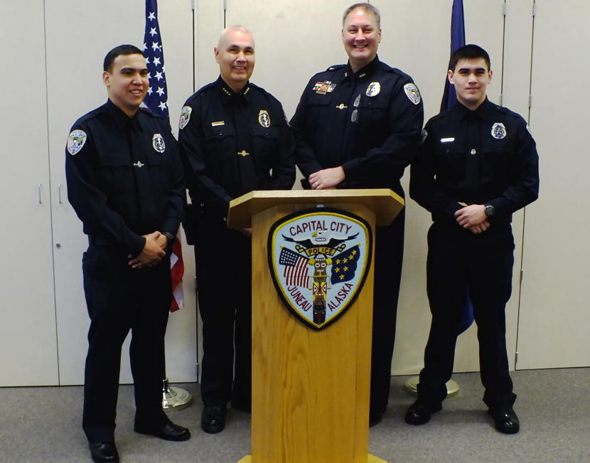 From left, new Juneau Police Officer Duain White, Chief Ed Mercer, Deputy Chief Dave Campbell, and new Officer Jonah Hennings-Booth pose for photos after a swearing in ceremony at the Juneau Police Department on Feb. 21, 2019.