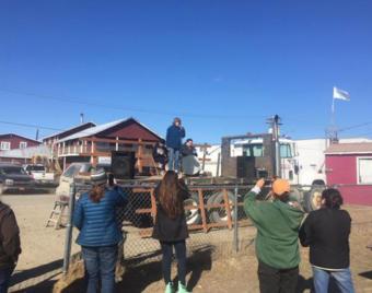Sen. Lisa Murkowski speaks to a crowd of people at Bethel's annual river breakup bash.