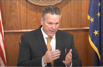 Alaska Gov. Mike Dunleavy speaks at his Tuesday news conference with a red pen in his jacket pocket — a reference to his veto power.