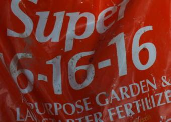 Front of bag of 16-16-16 fertilizer specifies proportions of nitrogen, phosphate, and potash.