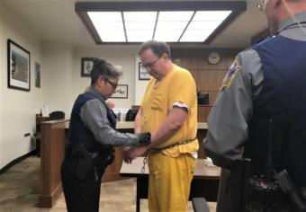 Doug Edwards is handcuffed following his sentencing hearing on April 18, 2019, in Ketchikan Superior Court.