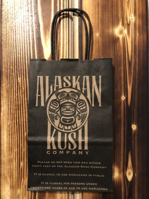Alaskan Kush Company warns customers about state laws regarding marijuana consumption by printing them on their bags. (Photo courtesy of Amy Herrick)