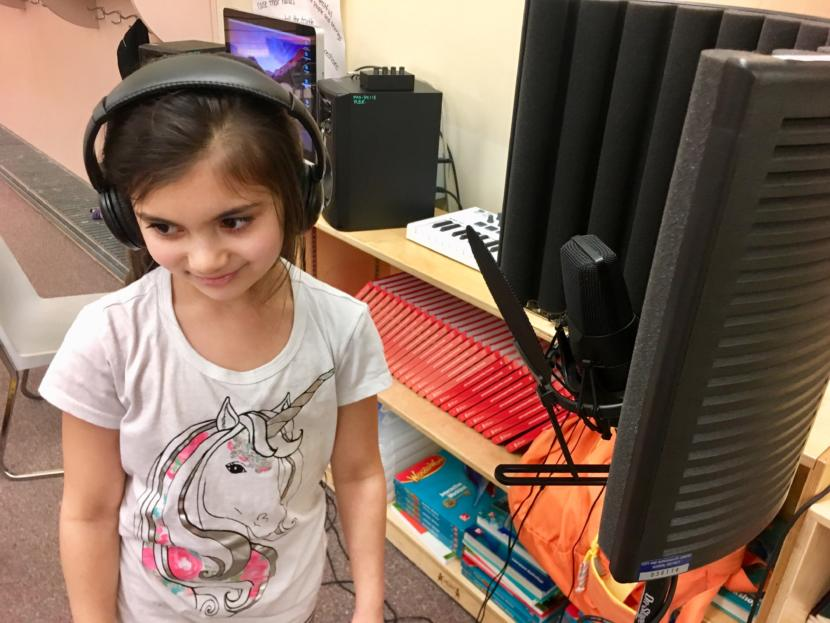 "Riverbend Elementary School 3rd grader Riley Severance on March 26, 2019. She sang on JAMM: The Album but wasn't completely satisfied with her performance. ""I sound like a baby!"" she said. (Photo by Zoe Grueskin/KTOO)"
