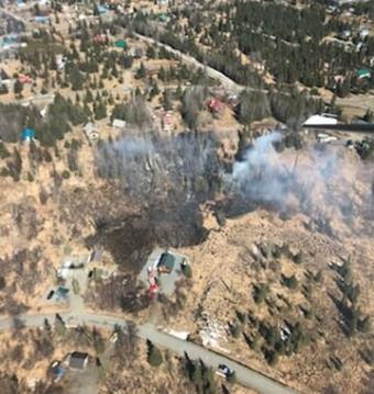 A 2.5-acre brush fire near Ninilchik on the Kenai Peninsula threatened homes Saturday.