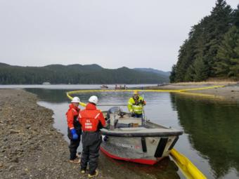 U.S. Coast Guard and Hecla Greens Creek Mine crews deploy a boom April 3, 2019 to contain a fictitious heavy fuel oil spill at Hawk Inlet. (Photo courtesy of Coast Guard Sector Juneau)