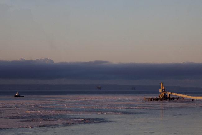 Cook Inlet oil platforms are visible from shore near Kenai, Alaska. (Photo by Rashah McChesney/Alaska's Energy Desk)