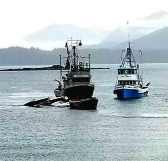 A Taquan Beaver is towed to shore after crashing into the water near Metlakatla, May 20, 2019. Both people on board were killed.